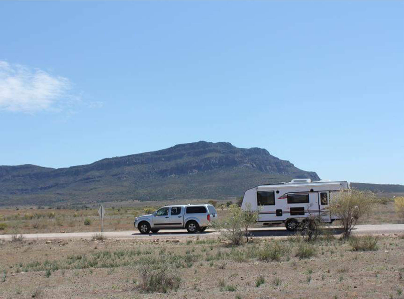 A 4x4 is towing a Newlands caravan