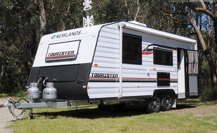 Newlands Tourister Caravan is being parked in the yard